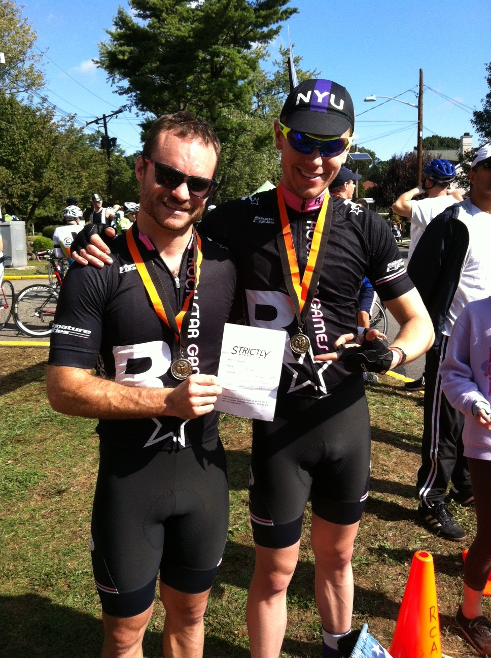 Caffery (L) and Wilson with their medals and the voucher Caffery won for a new Cannondale CAAD10 frameset.